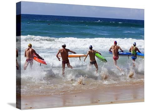 Surf Lifesavers Sprint for Water During a Rescue Board Race at Cronulla Beach, Sydney, Australia-Andrew Watson-Stretched Canvas Print