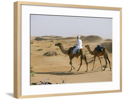 Bedu Rides His Camel Amongst the Sand Dunes in the Desert-John Warburton-lee-Framed Art Print