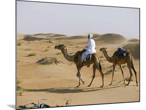 Bedu Rides His Camel Amongst the Sand Dunes in the Desert-John Warburton-lee-Mounted Photographic Print