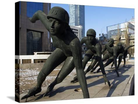 Northeast China, Heilongjiang Province, Harbin, A Statue of Female Ice Speed Skaters, China-Christian Kober-Stretched Canvas Print