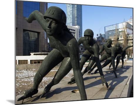 Northeast China, Heilongjiang Province, Harbin, A Statue of Female Ice Speed Skaters, China-Christian Kober-Mounted Photographic Print
