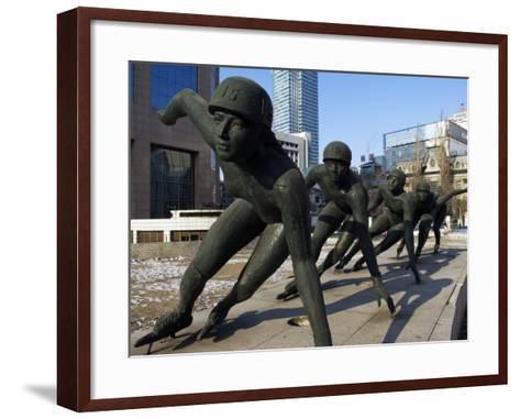 Northeast China, Heilongjiang Province, Harbin, A Statue of Female Ice Speed Skaters, China-Christian Kober-Framed Art Print