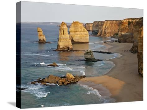 Victoria, Some of Twelve Apostles Standing in Shallow Water, Port Campbell National Park, Australia-Nigel Pavitt-Stretched Canvas Print