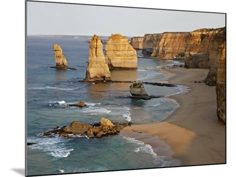 Victoria, Some of Twelve Apostles Standing in Shallow Water, Port Campbell National Park, Australia-Nigel Pavitt-Mounted Photographic Print