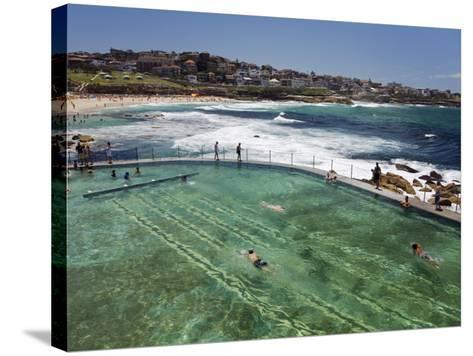 Swimmers Do Laps at Ocean Filled Pools Flanking the Sea at Sydney's Bronte Beach, Australia-Andrew Watson-Stretched Canvas Print