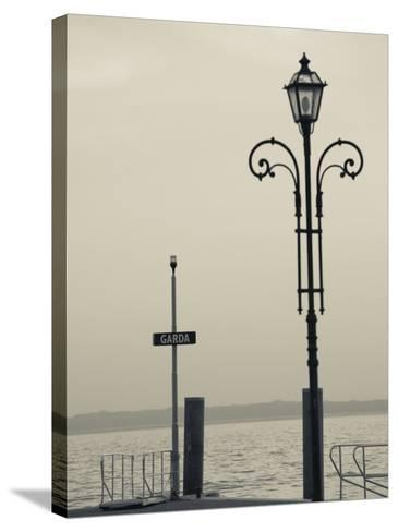 Veneto, Lake District, Lake Garda, Garda, Lakeside Pier View, Italy-Walter Bibikow-Stretched Canvas Print