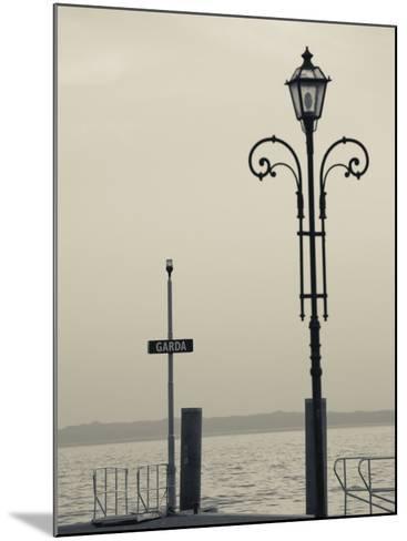Veneto, Lake District, Lake Garda, Garda, Lakeside Pier View, Italy-Walter Bibikow-Mounted Photographic Print