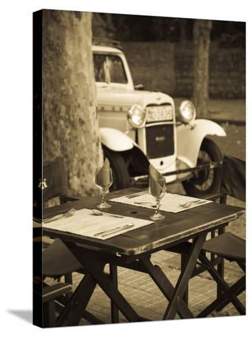Colonia Del Sacramento, Cafe Table and Old Car, Uruguay-Walter Bibikow-Stretched Canvas Print