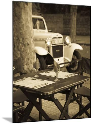 Colonia Del Sacramento, Cafe Table and Old Car, Uruguay-Walter Bibikow-Mounted Photographic Print