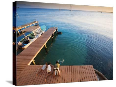 Bay Islands, Utila, Children Play on Jetty Outside Cafe Mariposa, Honduras-Jane Sweeney-Stretched Canvas Print