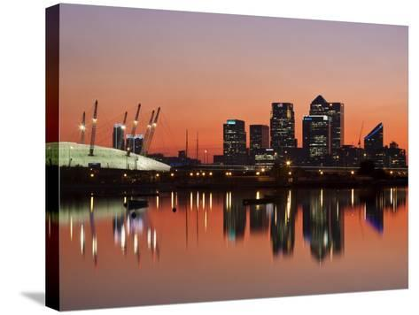 London, Newham, O2 Arena and Canary Wharf Buildings Reflecting in Royal Victoria Docks, England-Jane Sweeney-Stretched Canvas Print