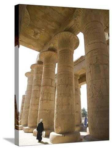 Man Walks Underneath the Giant Columns of the Hypostyle Hall in the Ramesseum, Luxor-Julian Love-Stretched Canvas Print