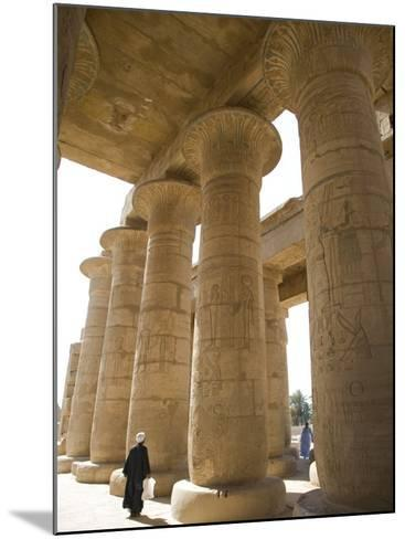 Man Walks Underneath the Giant Columns of the Hypostyle Hall in the Ramesseum, Luxor-Julian Love-Mounted Photographic Print