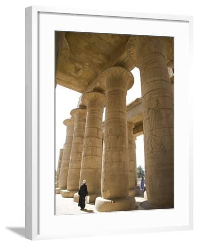 Man Walks Underneath the Giant Columns of the Hypostyle Hall in the Ramesseum, Luxor-Julian Love-Framed Art Print