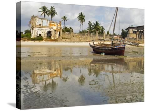 East Africa, Tanzania, Zanzibar, A Boat Moored on the Sands of Bagamoyo-Paul Harris-Stretched Canvas Print