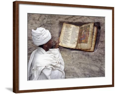 Priest of Ethiopian Orthodox Church Reads Old Bible at Rock-Hewn Church of Yohannes Maequddi-Nigel Pavitt-Framed Art Print