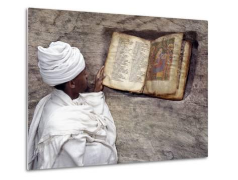 Priest of Ethiopian Orthodox Church Reads Old Bible at Rock-Hewn Church of Yohannes Maequddi-Nigel Pavitt-Metal Print