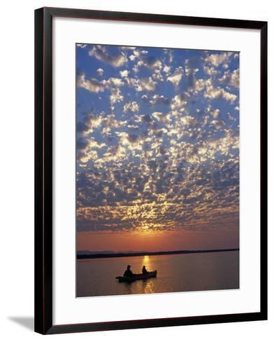 Canoeing under a Mackerel Sky at Dawn on the Zambezi River, Zambia-John Warburton-lee-Framed Art Print