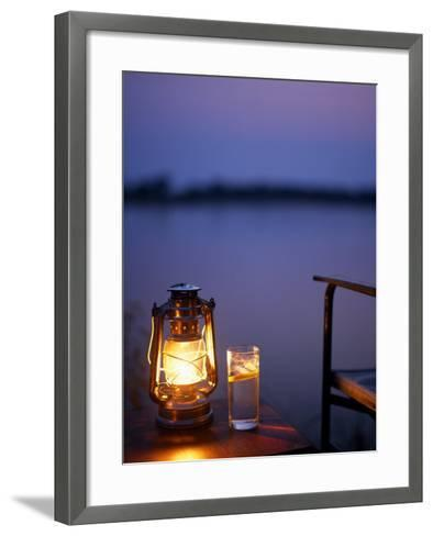 Gin and Tonic by the Light of Hurricane Lamp, Looking Out over the Zambezi River, Zambia-John Warburton-lee-Framed Art Print