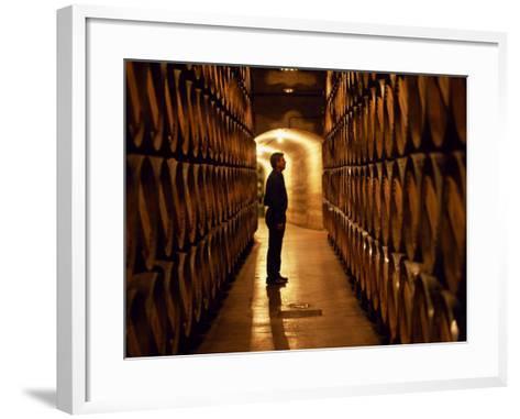 Foreman of Works Inspects Barrels of Rioja Wine in the Underground Cellars at Muga Winery-John Warburton-lee-Framed Art Print