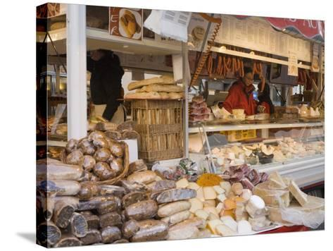 Stall Selling Cheese, Fruit Cake and Sausages at Christmas Market on Maxheinhardtplatz-Richard Nebesky-Stretched Canvas Print