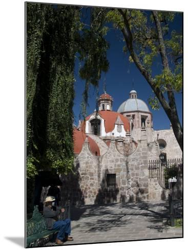 Local Man Resting on a Park Bench with Iglesia Del Carmen in Background, Morelia, Michoacan-Richard Maschmeyer-Mounted Photographic Print