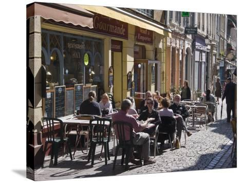 Terrace Tables Outside the Many Cafes and Restaurants on Rue De Lille in Old Quarter of Boulogne-Hazel Stuart-Stretched Canvas Print