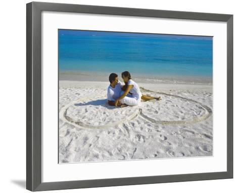 Young Couple on Beach Sitting in a Heart Shaped Imprint on the Sand, Maldives, Indian Ocean, Asia-Sakis Papadopoulos-Framed Art Print