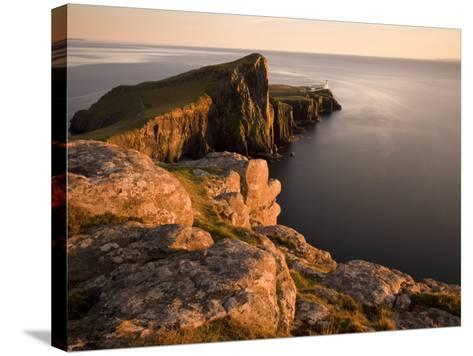Neist Point and Lighthouse Bathed in Evening Light, Isle of Skye, Highland-Lee Frost-Stretched Canvas Print