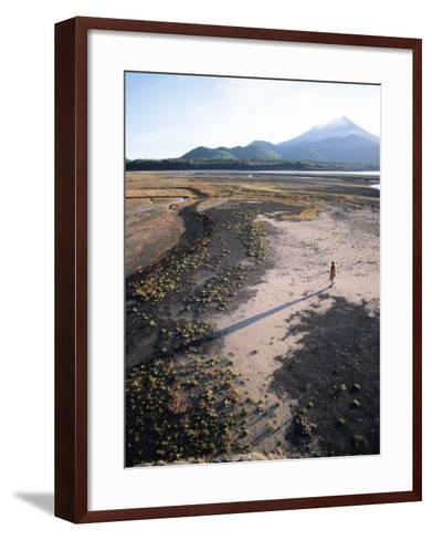 Man Walking on Dry Lake Bed with Llaima Volcano in Distance, Conguillio National Park, Chile-Aaron McCoy-Framed Art Print