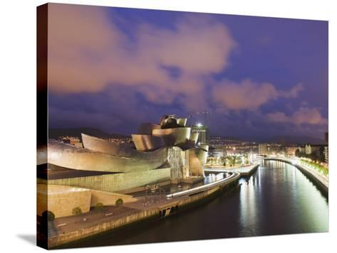The Guggenheim, Designed by Canadian-American Architect Frank Gehry, on the Nervion River-Christian Kober-Stretched Canvas Print
