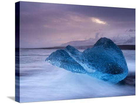 Translucent Blue Iceberg Washed Ashore on Breidamerkursandur Black Sands-Patrick Dieudonne-Stretched Canvas Print