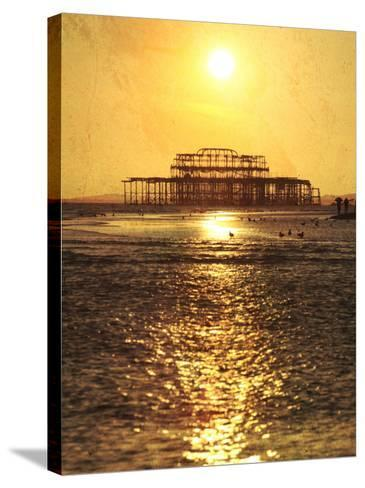 Sun over Ruin of West Pier, Brighton, Sussex, England-Neil Overy-Stretched Canvas Print