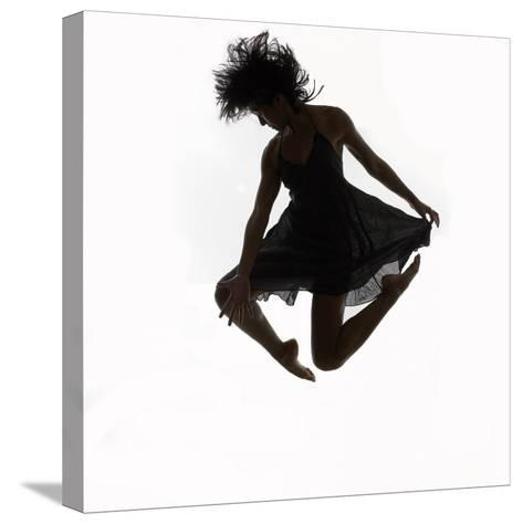 Woman Jumping in the Air Dancing-Alfonse Pagano-Stretched Canvas Print