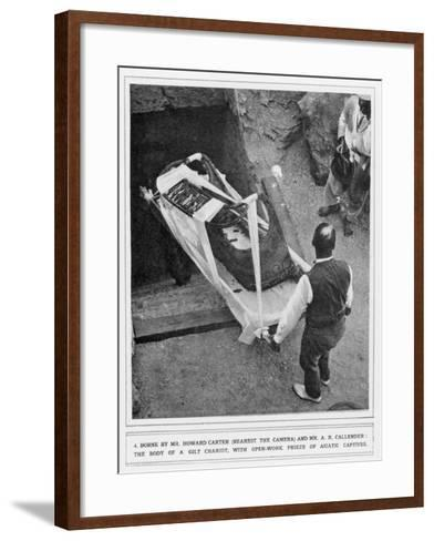 The Removal of a Gilt Chariot from the Tomb of Tutankhamun, by Howard Carter--Framed Art Print