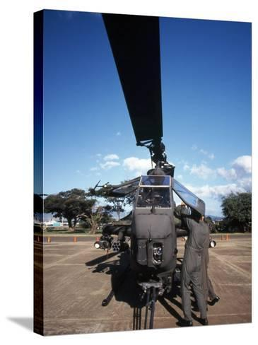 Air Crewmen Secure an AH-1 Cobra Attack Helicopter--Stretched Canvas Print