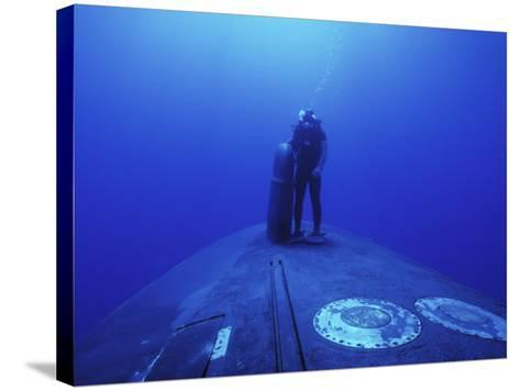 Navy Seal Stands Next to the Sonar Dome on the Bow of the USS Kamehameha--Stretched Canvas Print