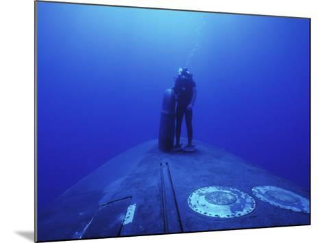 Navy Seal Stands Next to the Sonar Dome on the Bow of the USS Kamehameha--Mounted Photographic Print