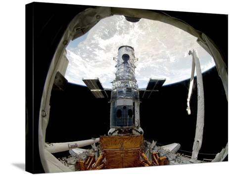 The Hubble Space Telescope, Locked Down in the Cargo Bay of Space Shuttle Atlantis--Stretched Canvas Print