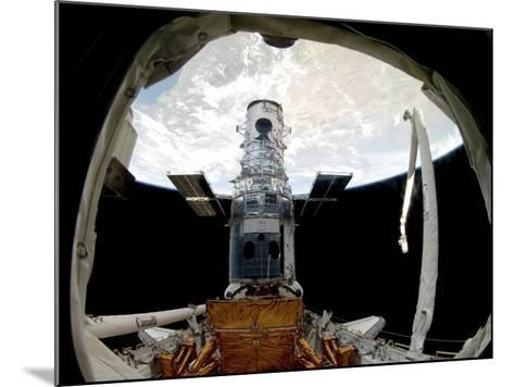 The Hubble Space Telescope, Locked Down in the Cargo Bay of Space Shuttle Atlantis--Mounted Photographic Print