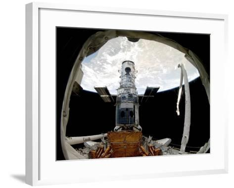 The Hubble Space Telescope, Locked Down in the Cargo Bay of Space Shuttle Atlantis--Framed Art Print