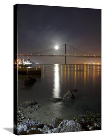 Harvest Moon Sets over the Tagus River and the City of Lisbon, Portugal--Stretched Canvas Print