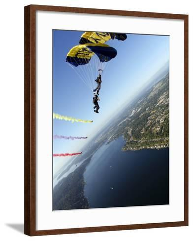 Members of US Navy Parachute Team, the Leap Frogs, Perform Bi-Plane with Parachutes Above Seattle--Framed Art Print