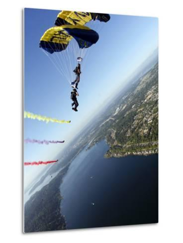 Members of US Navy Parachute Team, the Leap Frogs, Perform Bi-Plane with Parachutes Above Seattle--Metal Print