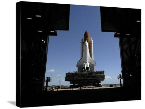 Atlantis Rolls Toward the Open Doors of the Vehicle Assembly Building at Kennedy Space Center--Stretched Canvas Print