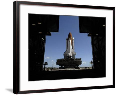 Atlantis Rolls Toward the Open Doors of the Vehicle Assembly Building at Kennedy Space Center--Framed Art Print