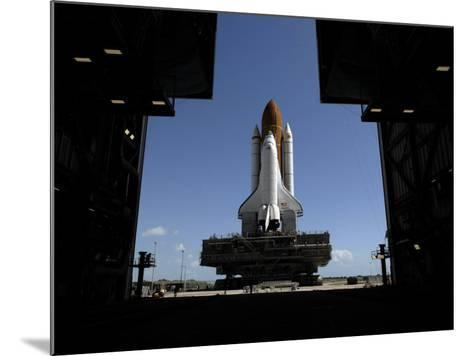 Atlantis Rolls Toward the Open Doors of the Vehicle Assembly Building at Kennedy Space Center--Mounted Photographic Print