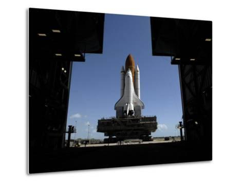 Atlantis Rolls Toward the Open Doors of the Vehicle Assembly Building at Kennedy Space Center--Metal Print