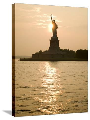 Sun Setting Behind the Statue of Liberty on a Summer Evening-John Nordell-Stretched Canvas Print