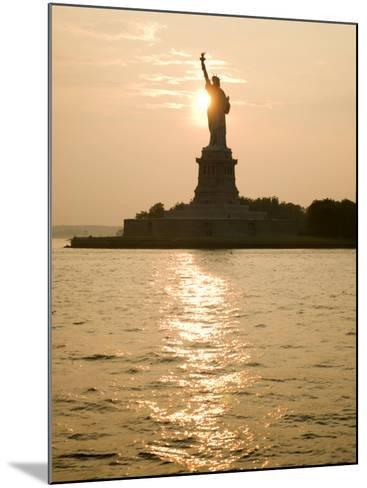 Sun Setting Behind the Statue of Liberty on a Summer Evening-John Nordell-Mounted Photographic Print